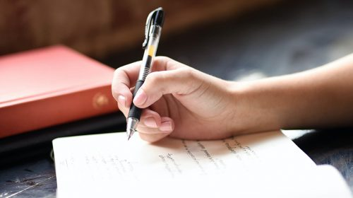 Close up of person writing