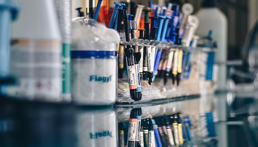 Assorted color syringes.