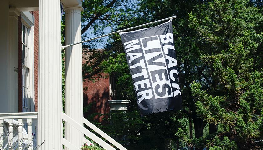 Black Lives Matter flag hanging on porch