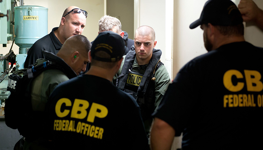 Members of Galveston County S.W.A.T. work with with Customs and Border Protection Agents during Maritime Tactical Operations Group vessel boarding training in the Houston Ship Channel, Aug. 23, 2016.