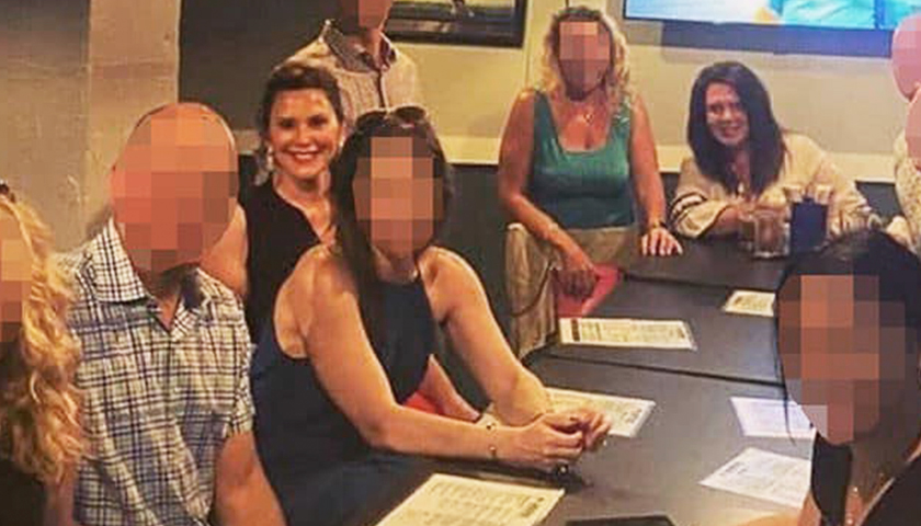 Gov. Whitmer at restaurant with large group