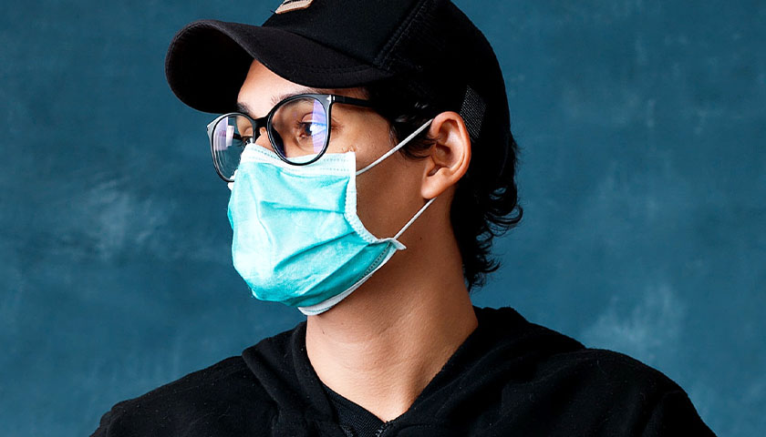 Guy wearing a mask