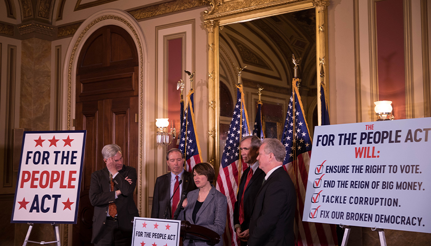 Legislators gather to discuss For The People Act.