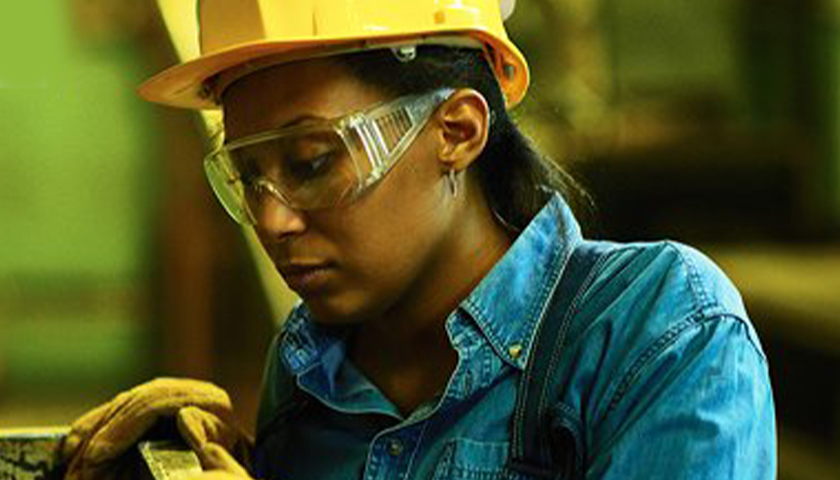 woman with a hard hat and safety glasses on